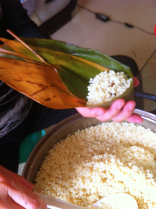 Then ladle in some glutinous rice, about eight or nine times full.